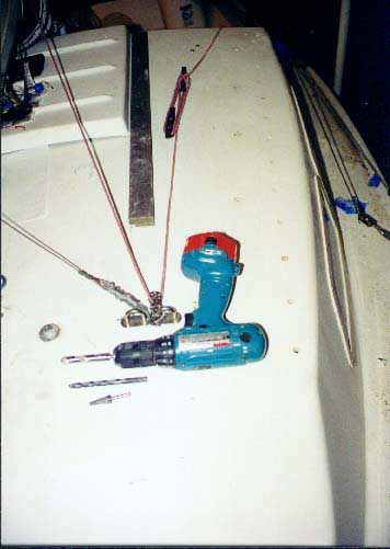 Drilling holes in sailboat deck for mounting genoa tracks